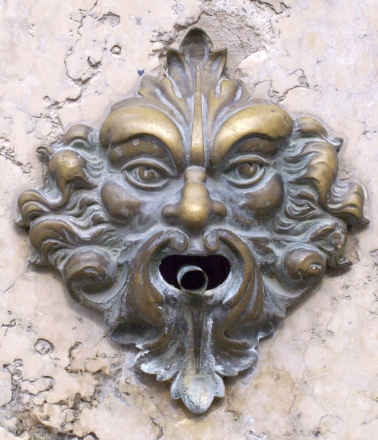 Bronze door bell in the form of a Green Man on the island of Murano, near Venice, Italy