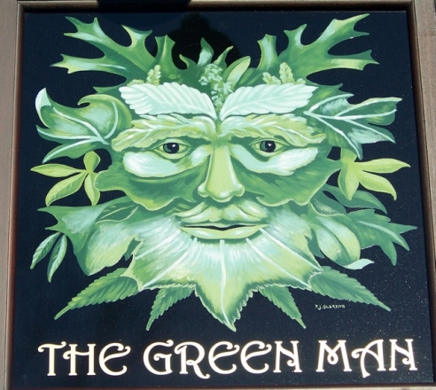 Green Man on a pub sign, near King's Stag, Dorset, England (photo Trish Steel, licensed for re-use)